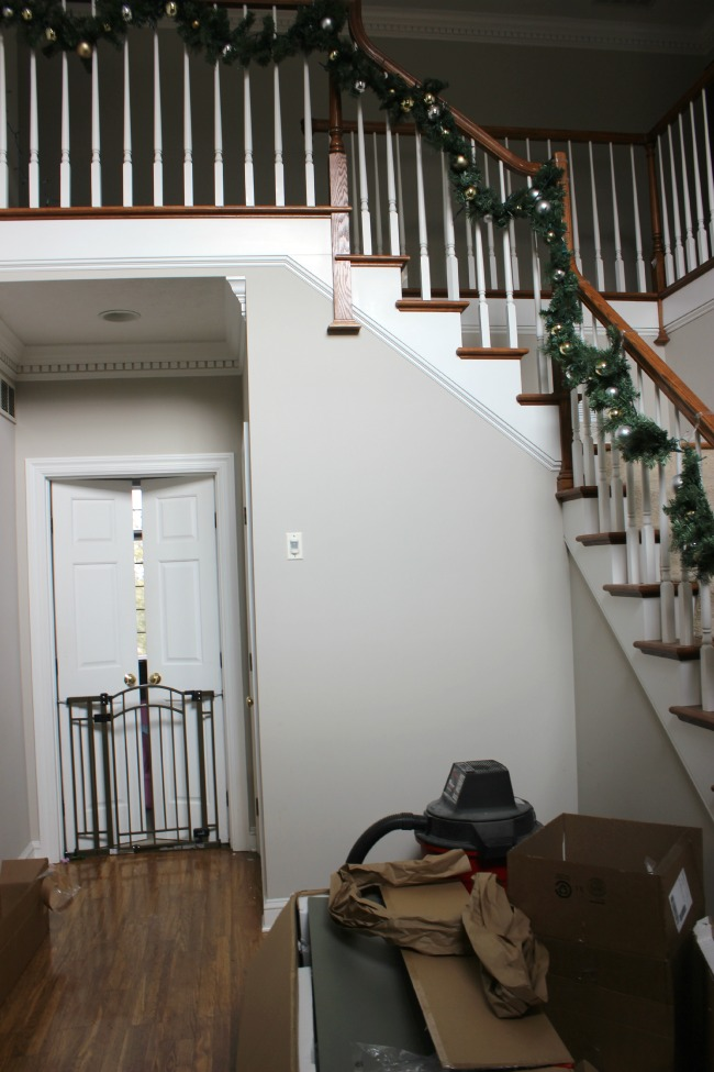 Transforming an entryway from a cluttered, uninviting mess to a beautiful and welcoming space.