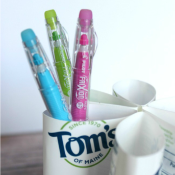 DIY Pen Organizer Toothbrush Hack. Upcycle your toothbrush containers and make your own pen, pencil, and art supply organizer with the toothpaste containers instead of throwing them away!